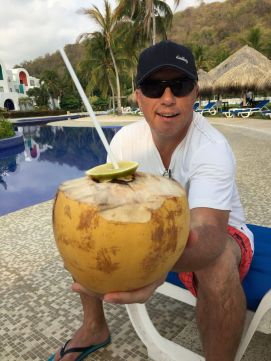 Turns out, you put the lime *on* the coconut. Enjoying a rum-based drink out of nature's finest serving ware. Credit: Therese Kehler, December 2016