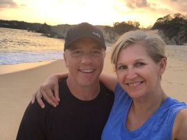 RoadWordy bloggers Dan and Therese in a sunset selfie on the beach. Credit: Therese Kehler, December 2016