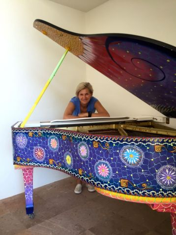 The colourful grand piano in the lobby bar of the Camino Real Zaashila. As out-of-tune as it is adorable. Credit: Dan Barnes