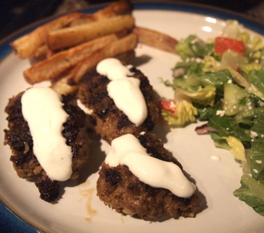 Kofte (spicy Turkish meatballs), with a garlicky yogurt dipping sauce.