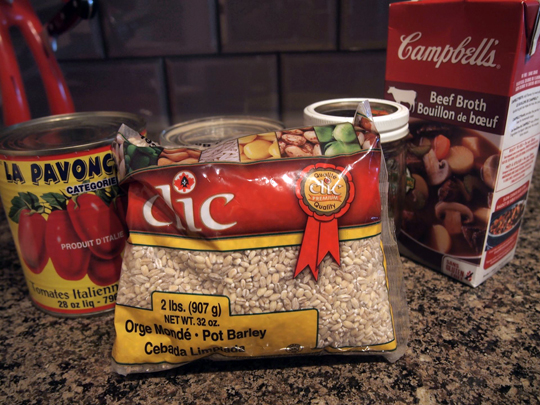 Barley, tomatoes and beef stock: key ingredients for hamburger soup (plus hamburger of course)