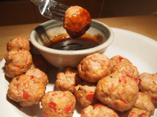 Asian-inspired turkey meatballs with a hoisin-based, sweet-and-salty dipping sauce