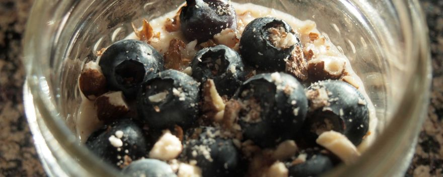 Simple and delicious, plain yogurt mixed with almond butter and honey, topped with blueberries and chopped almonds