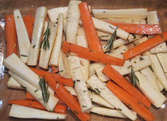 Prepping to make baked parsnips and carrots with rosemary