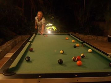 The mostly-outdoor pool tables in the lobby bar at the Camino Real Zaashila. The occasional ball rolling backwards added to the fun. Credit: Therese Kehler, December 2016