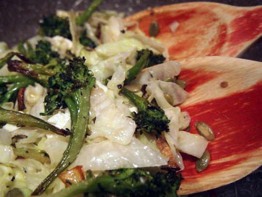 Tahini (a paste made from sesame seeds) flavours the dressing for this salad made with roasted broccoli and onions, iceberg lettuce, pumpkin seeds and feta.