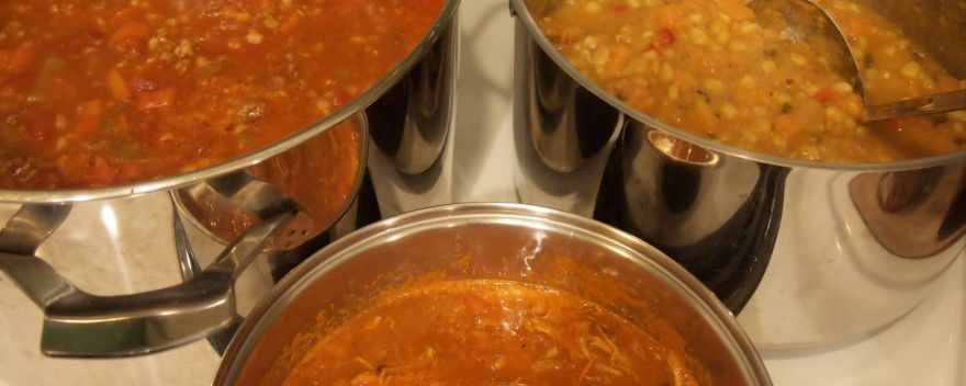 Three pots of soup on the stovetop