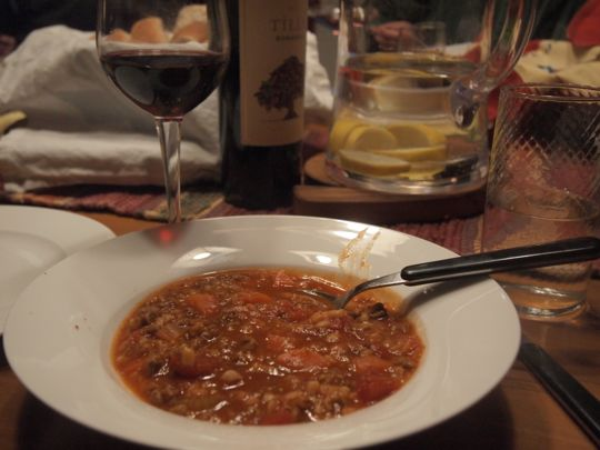 A bowl of hamburger soup at the dinner table