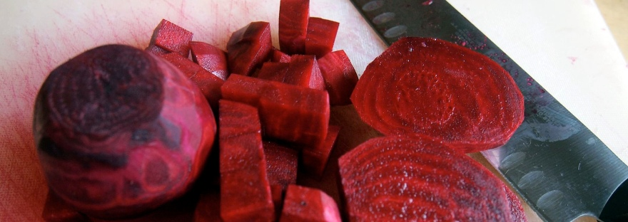 Making beet borscht: red stains and a big knife