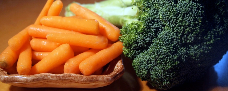 Miniature carrots and fresh broccoli combine in a roasted vegetable side dish.