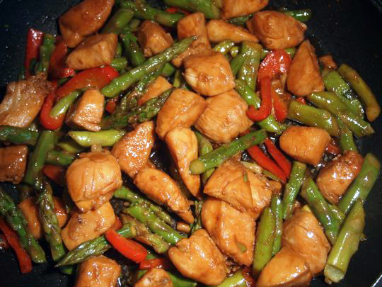 Stir-fried Chicken with Asparagus, with added red peppers and hot sauce