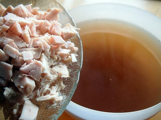 Broth from the freezer (which turned out to be a beef broth) and some leftover cooked chicken used in the soup.