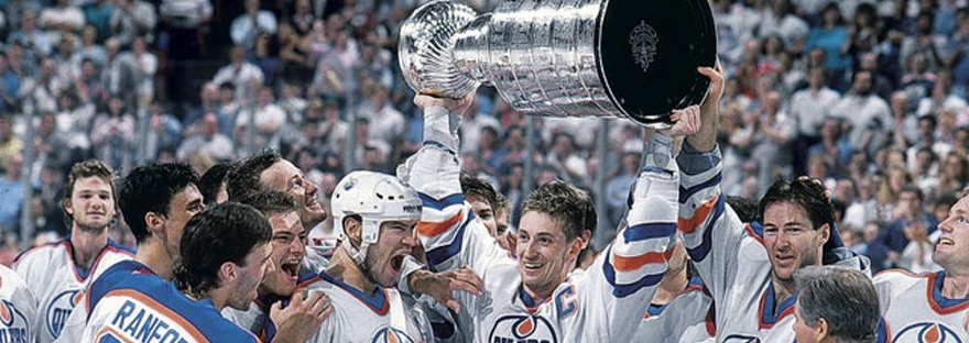 Wayne Gretzky hoists the Stanley Cup after beating Boston in 1988.