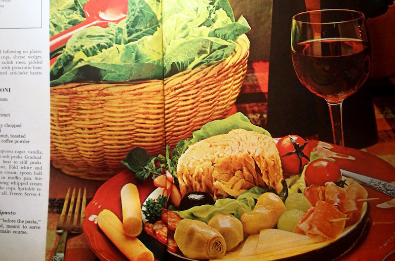 Fine dining in 1968 included things like antipasto plates involving what appears to be most of a can of tuna. Thank goodness there was also wine.