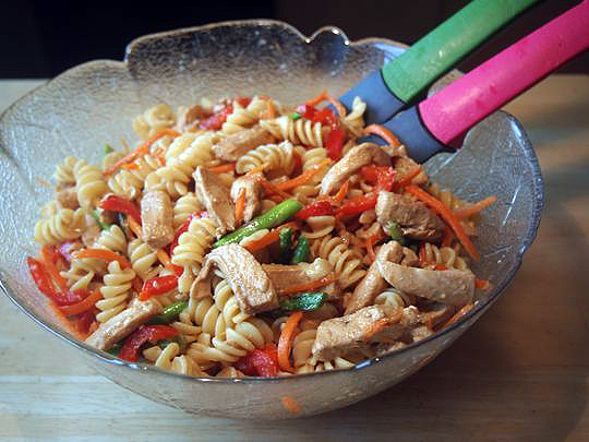 Colourful and filling, this Oriental Chicken Pasta Salad is good warm or cold.