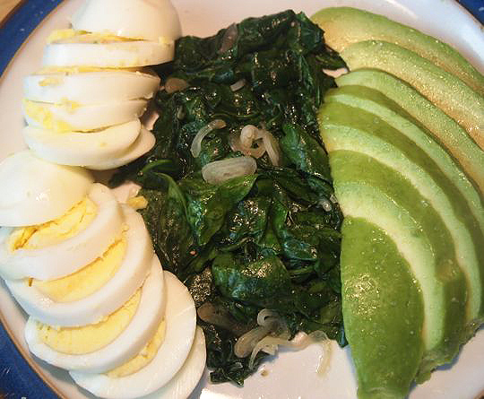 This photo might not look the most appetizing, but trust me on the fact that eggs, sauteed spinach and avocado are the basis of a delicious breakfast salad.