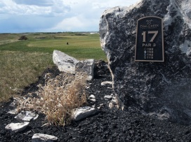The rugged mining theme is incorporated into the tee box design, as well as retired equipment in the rough.