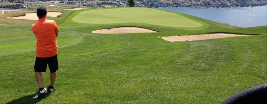 With a spectacular view of Okanagan Lake in the distance, Dan takes aim at the green at The Rise golf course in Vernon. B.C.
