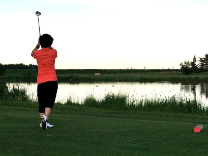 Sunny sends one across the pond and — hopefully — onto the green on the sixth hole at J.R. Golf Course.