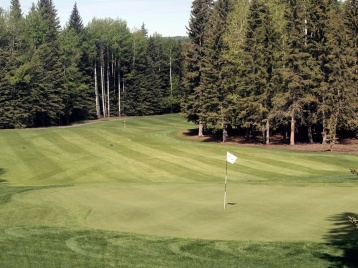 The 18th fairway of the Sundre Golf Club, seen from the patio.