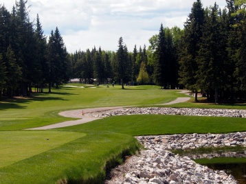 Narrow, treed fairways and rock-lined water hazards are hallmarks of the Sundre Golf Club.