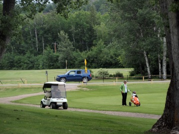 Golfaround players on the second fairway, after hitting their drives across the road.