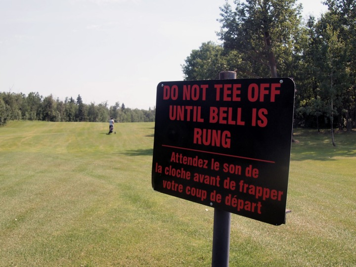 This sign on the first fairway is a good indication of what is to come — lots of hills, and more than a few blind holes.