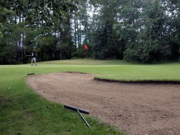 One of the sandtraps sheltering a green at Pineridge Golf Course near Seba Beach.