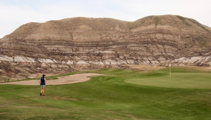 The badlands form almost a natural stadium around this green on the back nine